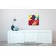 Tableau coloré au-dessus d'un meuble contemporain The kiss